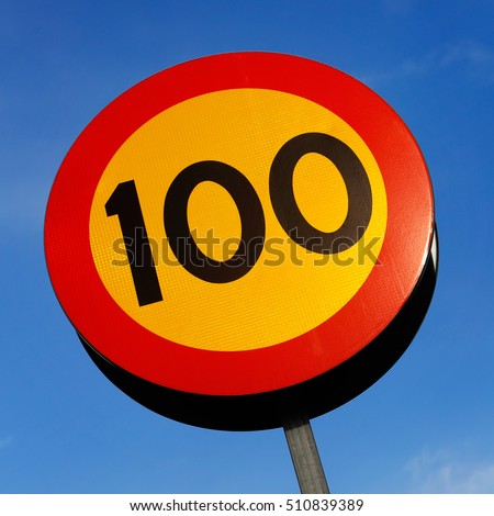 Speed limit 100 on blue sky. #510839389