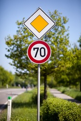 Speed limit road sign of 70 kilometres per hour on the side of a rural road