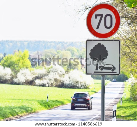 speed limit road sign on road witg blurred background from car #1140586619