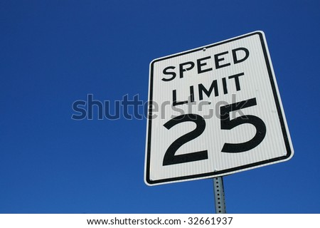 Speed limit sign against blue sky back ground room for copy space - stock photo