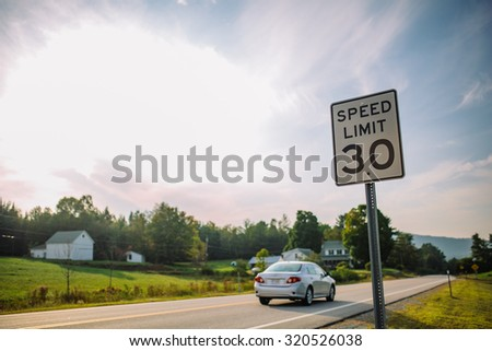 Speed limit sign on a highway #320526038