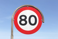 Speed limit traffic sign 80 on the road
