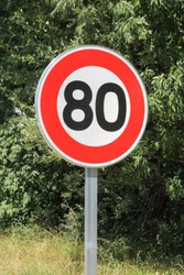 Speed limit traffic sign 80 on the road in France