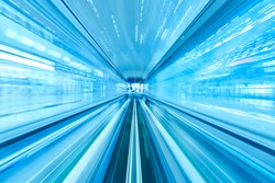 Speed Motion Blur Line of Railway Tunnel and Light at the end of Tunnel of Airport in Blue Tone