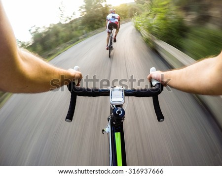 Speed on bike, Couple of cyclist during a road race. Pov, original point of view #316937666