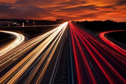 Speed Traffic - light trails on motorway highway at night,  long exposure abstract urban background