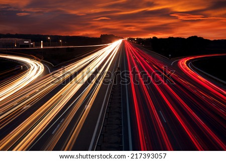 Speed Traffic - light trails on motorway highway at night,  long exposure abstract urban background #217393057