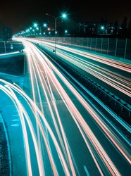 Speed Traffic - long time exposure on highway with car light trails at night