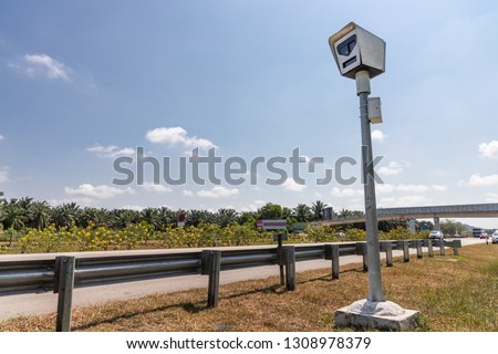 Speed trap surveillance camera along highway to control speeding to reduce speeding related accident #1308978379