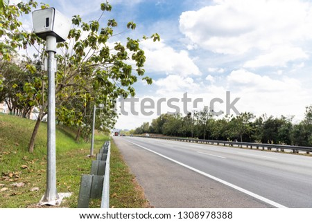 Speed trap surveillance camera along highway to control speeding to reduce speeding related accident #1308978388