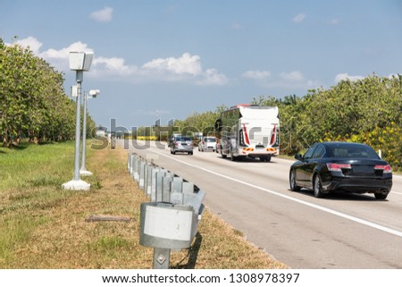 Speed trap surveillance camera along highway to control speeding to reduce speeding related accident #1308978397