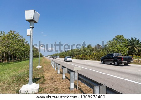 Speed trap surveillance camera along highway to control speeding to reduce speeding related accident #1308978400