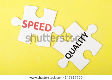 Speed versus quality concept on two pieces of puzzles - stock photo
