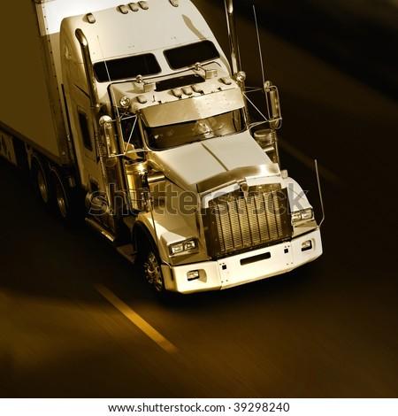 speed yellow semi-truck on highway