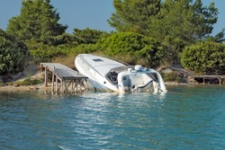 Speedboat beached and almost sunk at it's mooring