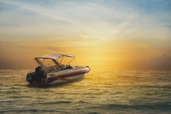 Speedboat is in the sea in beautiful sunset.