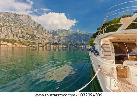 speedboat near the pier on mountains background. Montenegro