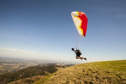 speedflying paraglider launching in sunny day