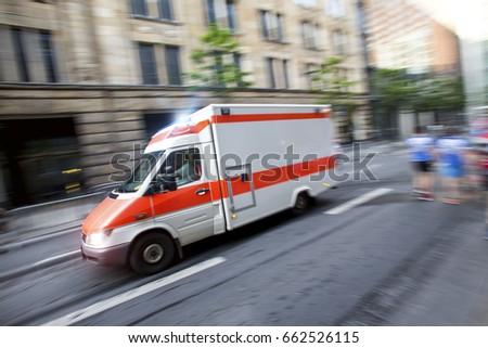 speeding ambulance car in a city