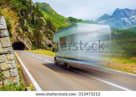 Speeding Camper on a Mountain Road. Class C Recreational Vehicle. Vacation Adventures.