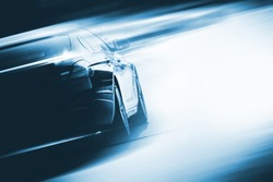 Speeding Car Background Photo Concept. Vehicle on a Road. Motorsport Backdrop Concept with Copy Space.