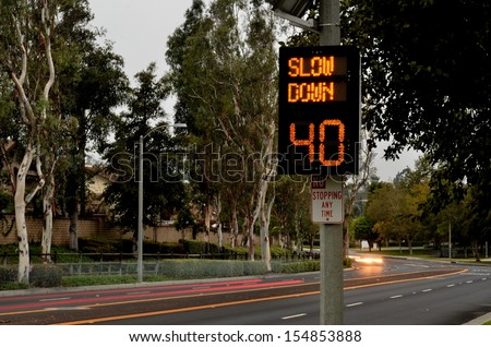 Speeding cars and traffic warning sign/Traffic Speed Zone.Illuminated traffic speed warning sign with speeding cars
