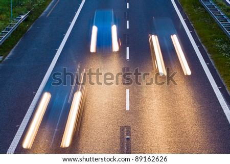 Speeding cars on a highway, motion blur