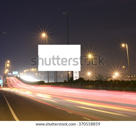 Speeding cars on modern Road infrastructure with blank hoarding for text messages, artistic long exposure shot Stock foto ©