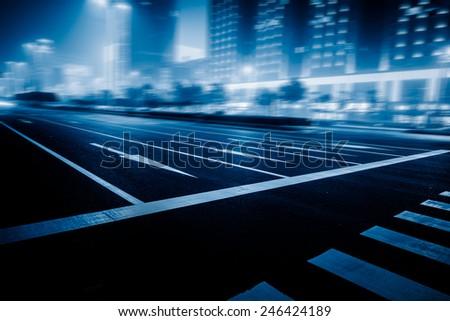 speeding lights of cars in city at night. #246424189