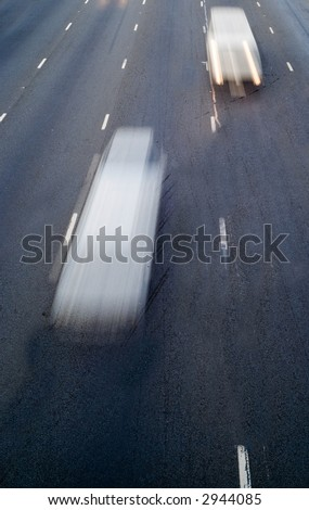 Speeding motion blur fast speeding traffic on highway road