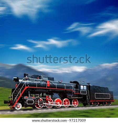 Speeding old locomotive in mountains - stock photo