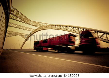 speeding truck go through the bridge.