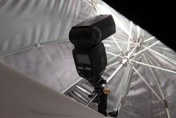 Speedlite firing inside octagonal umbrella softbox