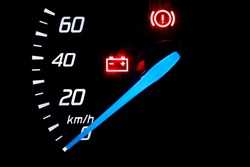 Speedometer in kilometers hour of a combustion car on the dashboard.