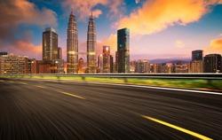 Speedy motion forward flyover with beautiful Kuala Lumpur city skyline , Sunset scene .