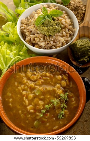 spelt soup and spelt with pesto - stock photo