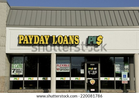 SPENCER , WISCONSIN Sept.28 , 2014: Payday Loans Sign on a Store Front. Payday Loans is a short term loan company.