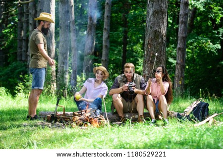 Spend great time on weekend. Halt for snack during hiking. Camping and hiking. Company friends relaxing and having snack picnic nature background. Company hikers relaxing at picnic forest background.