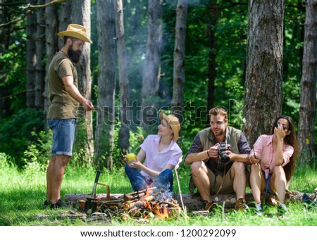 Spend great time on weekend. Halt for snack during hiking. Company friends relaxing and having snack picnic nature background. Camping and hiking. Company hikers relaxing at picnic forest background.