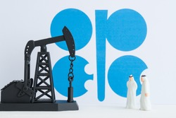 Spending or investment of a country's revenues from petroleum exports industry (Petrodollar). Oil pump jack and arab men with OPEC flag background. Concept of crude oil production, petroleum industry.