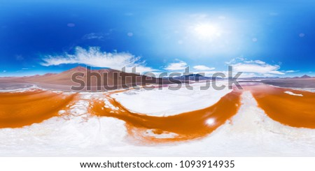 Spherical, 360 degrees, seamless aerial panorama of the Laguna Colorada with orange water and salt fields and salt islets. Lake is located in Eduardo Abaroa Andean Fauna National Reserve, Bolivia