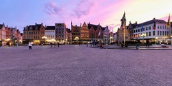Spherical 360 panorama Bruges Grote markt square with Belfry tower and Provincial Court building famous tourist destination and in Bruges, Belgium on dusk in twilight