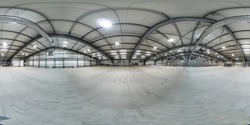 Spherical panorama 360 degree of empty warehouse with metal construction. Distribution storehouse. Storage equipment.