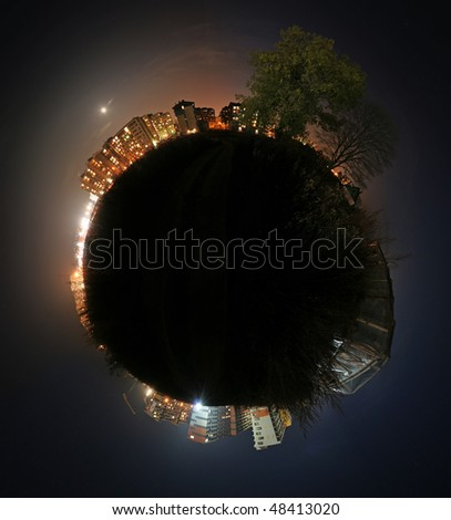 Spherical panorama. Night time landscape of living area with lights in windows.
