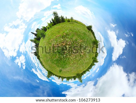 Spherical panorama of a green meadow with trees and blue summer cloudy sky - stock photo