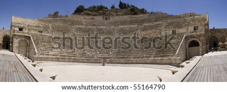 Spherical Panoramic view of the ancient Roman theater seats and stage in Amman - Jordan. Photo taken in a sunny day, over a clear blue sky.