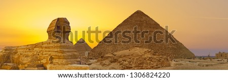 Sphinx against the backdrop of the great Egyptian pyramids. Africa, Giza Plateau.