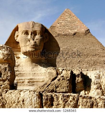 Sphinx and pyramid in Giza Cairo Egypt - stock photo