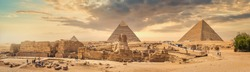 Sphinx and pyramids in the egyptian desert