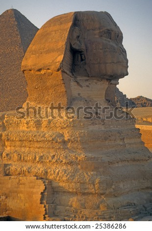 Sphinx at sunset, with pyramids in background,   Giza Egypt, Middle East
